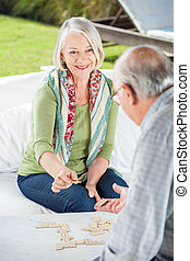 Senior Couple Playing Dominoes - Happy senior woman playing ...