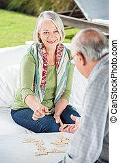Senior Couple Playing Dominoes