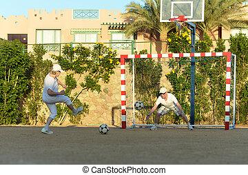 Senior couple playing football