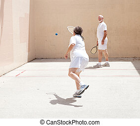 Senior Couple Playing Racquetball