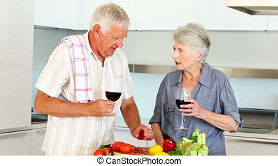 Senior couple preparing a healthy m