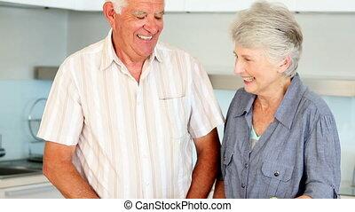 Senior couple preparing a healthy m - Senior couple...