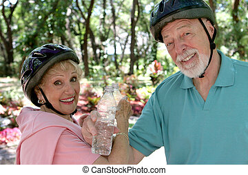 Senior Couple Refreshment - A fit senior couple cooling off...