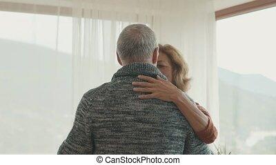 Senior couple relaxing at home, dancing. - Happy senior...