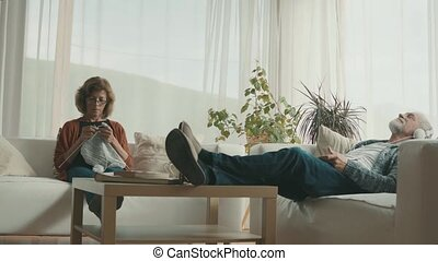 Senior couple relaxing at home. - Happy senior couple...