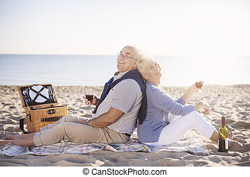 Senior couple relaxing with a bottle of wine
