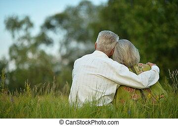 Senior couple resting at park - Portrait of a senior couple...