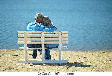 Senior couple resting at park