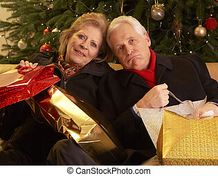 Senior Couple Returning After Christmas Shopping Trip