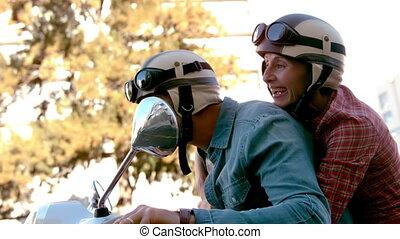 Senior couple riding a scooter