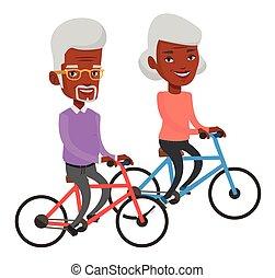 Senior couple riding on bicycles.