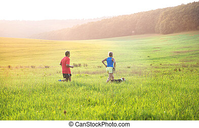 Senior couple running - Active seniors running with their...