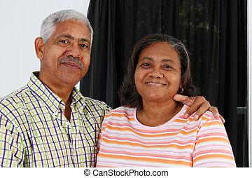 Senior Couple - Senior Minority Couple Standing In Their...