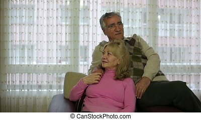 Senior couple sitting on sofa