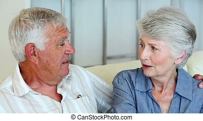 Senior couple sitting on the couch