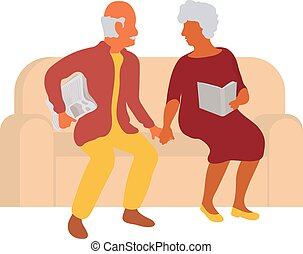 Senior couple sitting together on a couch and holding hands