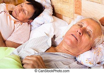 Senior couple sleeping
