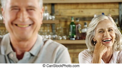 Senior couple smiling in the cafe 4k