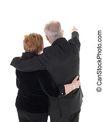 Senior couple standing from back.