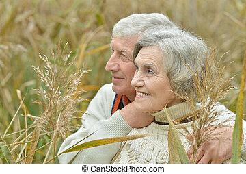 Senior couple standing in autumn