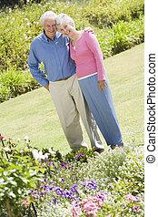 Senior couple standing in garden