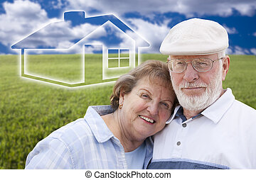 Senior Couple Standing in Grass Field with Ghosted House Behind