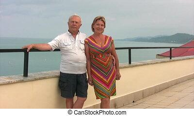 senior couple standing near balustrade - happy senior couple...