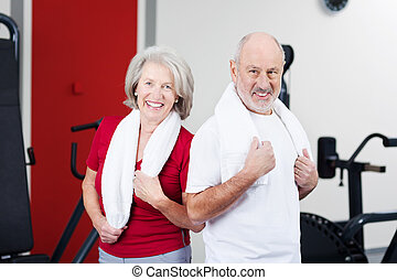 Senior Couple Standing Together In Gym