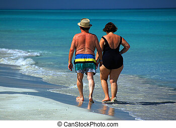 Senior Couple Enjoying A Beach Stroll