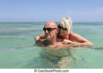 senior couple swimming