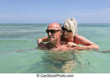 senior couple swimming