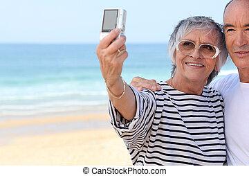 Senior couple taking a photo