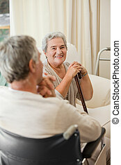 Senior couple talking in a hospital room