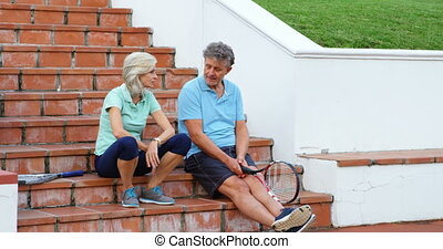 Senior couple talking on stairs 4k - Senior couple talking...