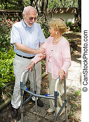 Senior Couple Together - Senior couple outdoors. She\\\'s in...