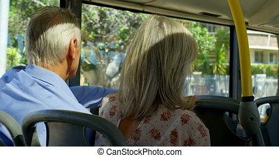 Senior couple travelling in bus 4k