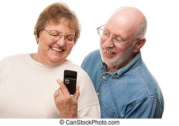 Senior Couple Using Cell Phone