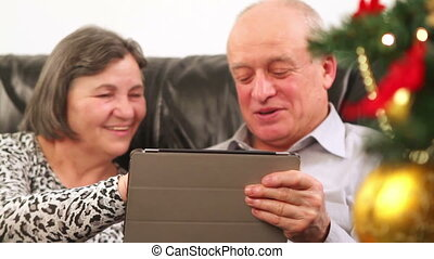 Senior couple using digital tablet