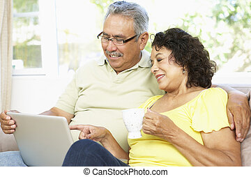 Senior Couple Using Laptop At Home