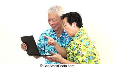 Senior couple video call holiday