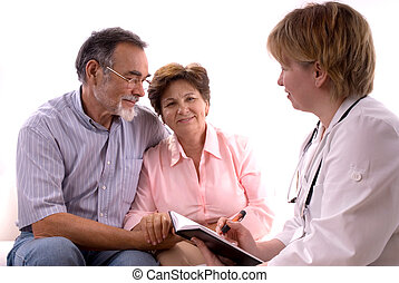 visiting a doctor - senior couple visiting a doctor