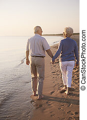 Senior couple walking hand by hand