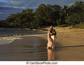 senior couple walking on a maui beach