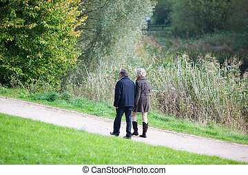 Senior couple walking together on an alley