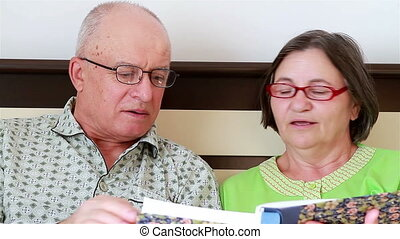 Senior Couple Watching Photo Album