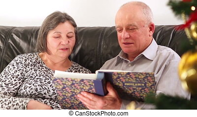 Senior couple watching photos
