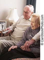 Senior Couple Watching TV At Home