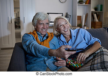 Senior Couple Watching TV at Night
