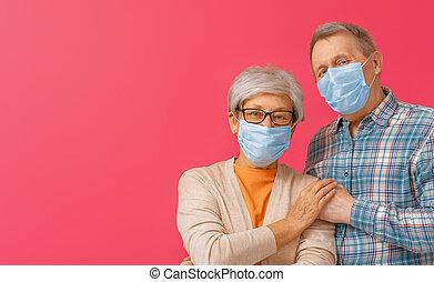 Senior couple wearing facemask during coronavirus and flu ...