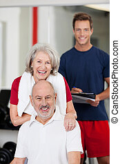 Senior couple with a fitness trainer